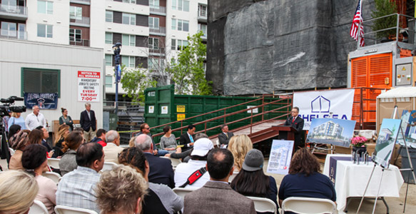 <span>Topping Off for Alpha Square</span><br>A 6-foot evergreen tree for long life was placed atop Alpha Square, an SDHC partnership development that will provide 201 affordable apartments for homeless and low-income renters.  Read News Release 4.24.15.