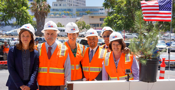 <span>Ceremony 'Tops Out' New Affordable Housing</span><br>Construction milestone for Atmosphere, an SDHC partnership development, that's replacing a vacant lot in Downtown San Diego with 202 affordable housing units, including 51 units to address homelessness. Read the news release 7.14.16.