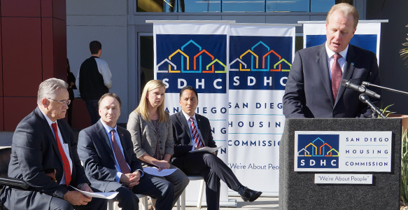 <span>HOUSING FIRST – SAN DIEGO: New Initiatives</span><br>Three new initiatives announced for SDHC's Homelessness Action Plan: unprecedented rental assistance program for 100 SDSU students impacted by homelessness; Federal housing vouchers for 25 families at Monarch School; and $10 million for affordable housing. Watch Video 12.3.15